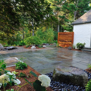 Inspiration for a mid-sized zen side yard stone patio fountain remodel in Boston with no cover