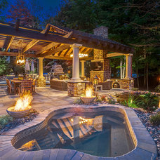 Rustic Patio by Hidden Creek Landscaping, Inc.