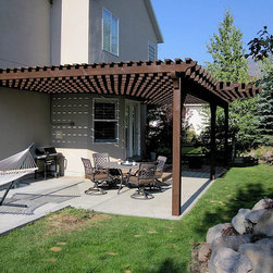 Attached Pergola Wilson Residence - In just a few short hours a sturdy timber frame attached pergola kit is easily assembled over a backyard patio for shade and a place to gather. These are durable strong timbers built with the old world dovetail mortise and tenon system to last for generations and stand up through strong winds and heavy mountainous snows.