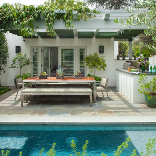 Inspiration for a medium sized mediterranean back patio in Los Angeles with an outdoor kitchen, a pergola and concrete paving.