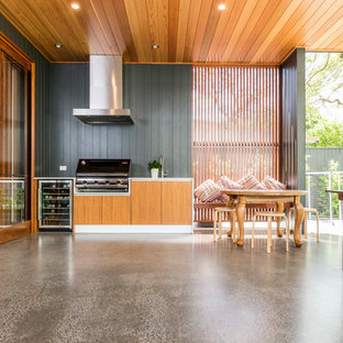 Inspiration for a contemporary backyard patio in Brisbane with an outdoor kitchen, concrete slab and a roof extension.