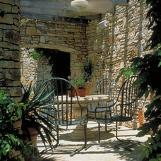 Mediterranean Patio by McDugald-Steele Landscape Architects