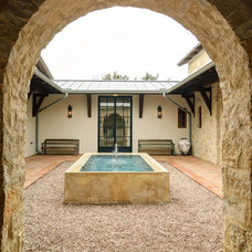 Rustic Patio by Design Visions of Austin