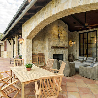 Example of a mountain style patio design in Austin with a fire pit