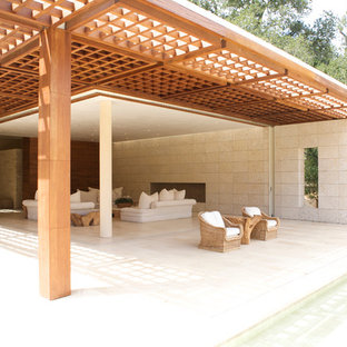 Design ideas for a large contemporary patio in San Francisco with a roof extension.