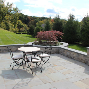Example Of A Large Classic Backyard Tile Patio Design In New York With A  Fire Pit