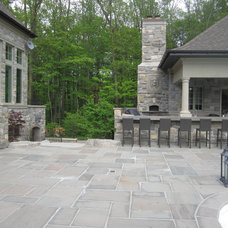 Rustic Patio by Segreti Design
