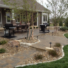 Traditional Patio by Landmark Landscape and Construction