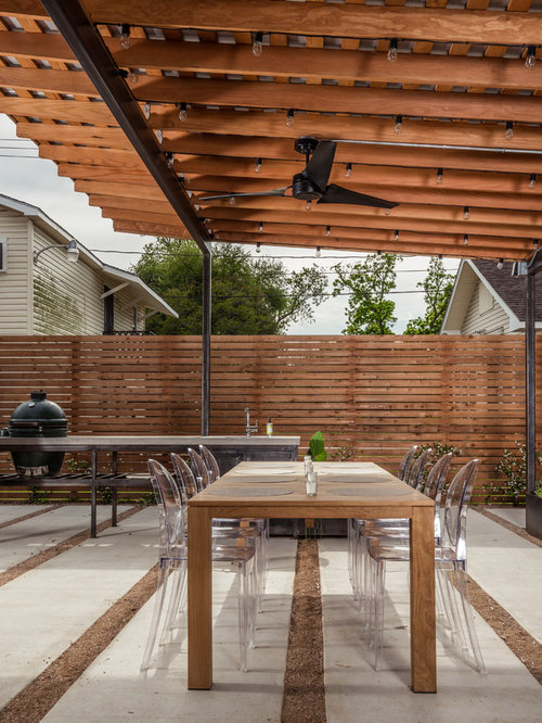 Inspiration For A Contemporary Backyard Concrete Paver Patio Kitchen  Remodel In Houston With A Roof Extension