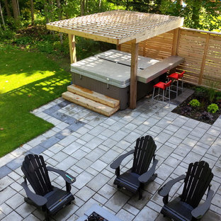 Example Of A Mid Sized Minimalist Backyard Tile Patio Design In Toronto  With A Pergola