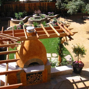 Inspiration for a large mediterranean backyard decomposed granite patio kitchen remodel in San Francisco