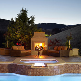 Example of a large classic backyard patio design in San Francisco with a fire pit and no cover