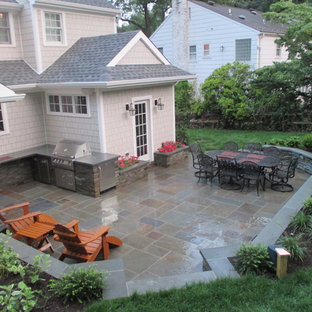 Mid-sized elegant backyard tile patio kitchen photo in New York with no cover