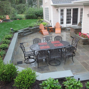 Inspiration for a mid-sized timeless backyard tile patio kitchen remodel in New York with no cover