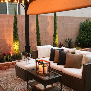 Patio - small transitional backyard concrete paver patio idea in Las Vegas with a pergola