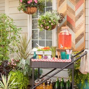 Foto di un patio o portico stile shabby di medie dimensioni e dietro casa