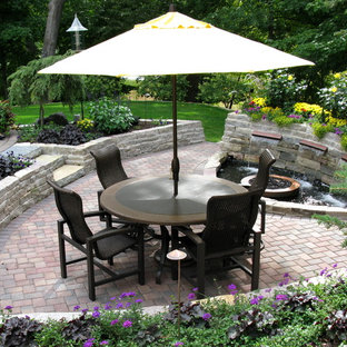 Elegant patio photo in Minneapolis with a fire pit