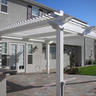 Patio - mid-sized traditional backyard patio idea in San Francisco with a pergola