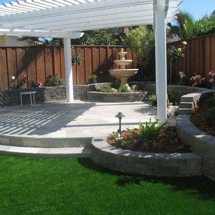 Mid-sized elegant backyard patio photo in San Francisco with a pergola