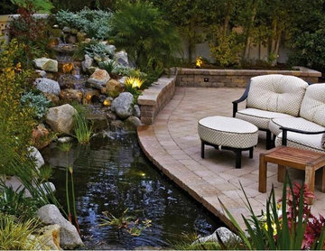 Backyard Pond and Patio with a Rock Waterfall