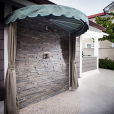 Beach Style Patio by JB Turner & Sons