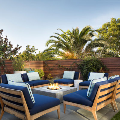 Example of a mid-sized trendy backyard concrete patio design in San Francisco with no cover and a fire pit