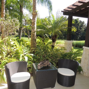Example of a coastal patio design in Other