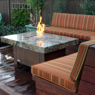 Example of a small eclectic backyard patio design in Orange County