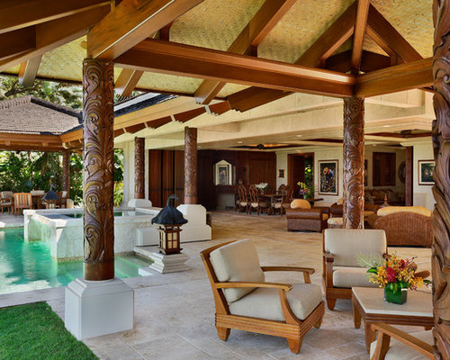 Example of a large island style courtyard stone patio fountain design in  Hawaii with gazebo Bali Style Houzz