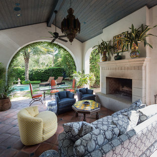 Large tuscan backyard tile patio photo in Houston with a fire pit
