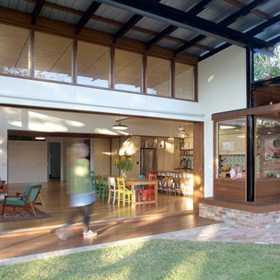 Design ideas for a medium sized contemporary back patio in Brisbane with an outdoor kitchen, brick paving and an awning.