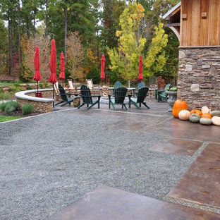 Inspiration for a timeless patio remodel in Other with a fire pit