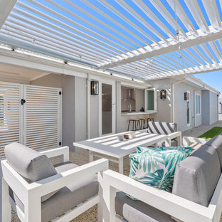 This is an example of a contemporary backyard patio in Perth with a pergola.