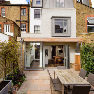 Medium sized traditional back patio in London with no cover.
