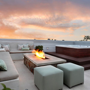 Coastal patio photo in Orange County with a fire pit