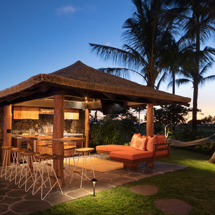 Example of a mid-sized island style backyard stone patio kitchen design in Hawaii with a gazebo