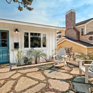 Mid-sized coastal front yard stone patio photo in Los Angeles with no cover