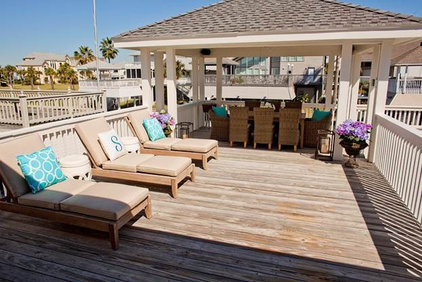 Beach Style Patio by Munger Interiors