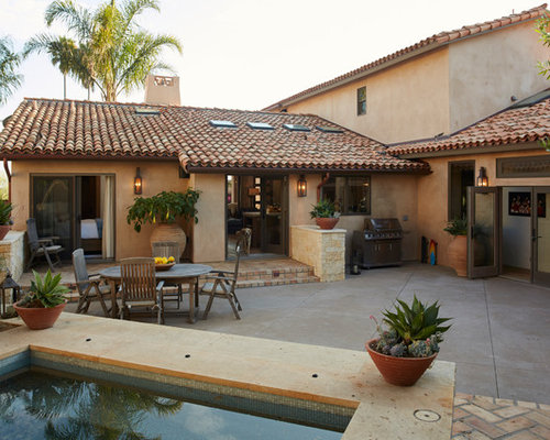 Example Of A Large Southwest Backyard Patio Design In Other