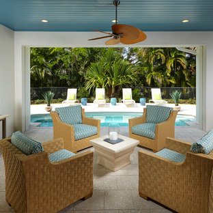 Inspiration for a beach style backyard patio remodel in Miami with a roof extension