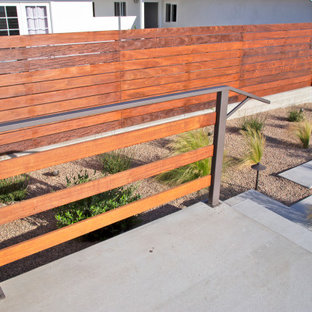 This is an example of a mid-sized modern front yard patio in San Luis Obispo with concrete slab.