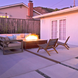 Mid-sized modern front yard patio in San Luis Obispo with concrete slab.