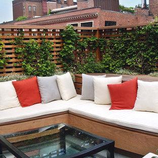 Small trendy stone patio container garden photo in Boston