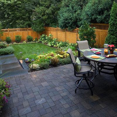 Example of a trendy backyard patio design in Minneapolis