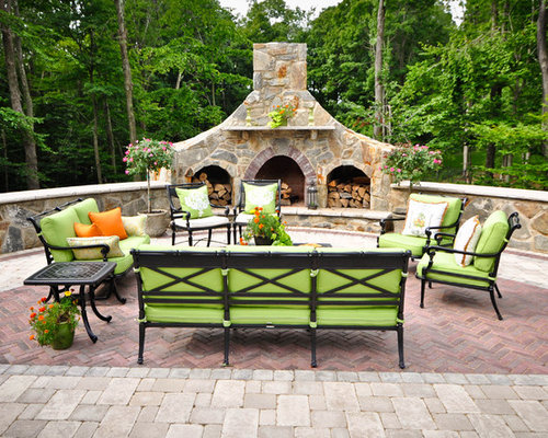 Example Of A Classic Brick Patio Design In New York With A Fire Pit