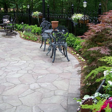 Traditional Patio by Action Landscaping Inc