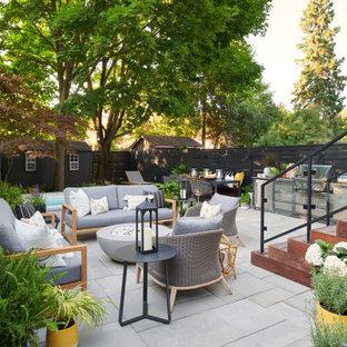 Ispirazione per un patio o portico design dietro casa con nessuna copertura