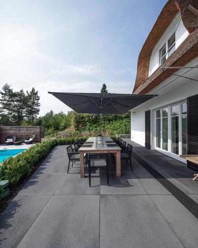 Modern Patio by METTEN Stein+Design GmbH & Co. KG