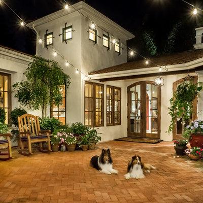 Patio - large mediterranean courtyard brick patio idea in San Francisco with no cover