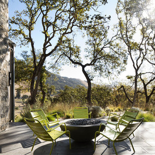 Example Of A Country Courtyard Tile Patio Design In San Francisco With A  Fire Pit